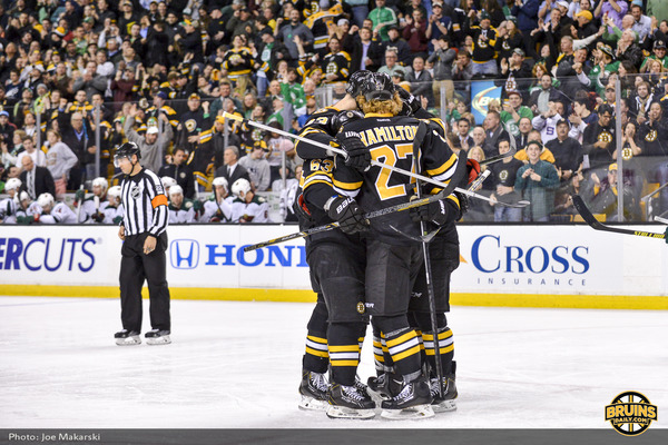 Bruins celebrate vs Wild.jpg
