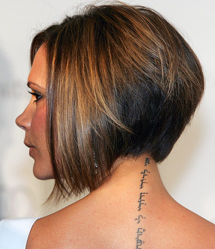 features Beckham's famous angel tattoo!