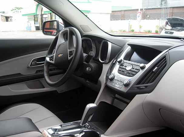 2010-Chevrolet-Equinox-interior.jpg. Up front is a space-age V-shaped dash