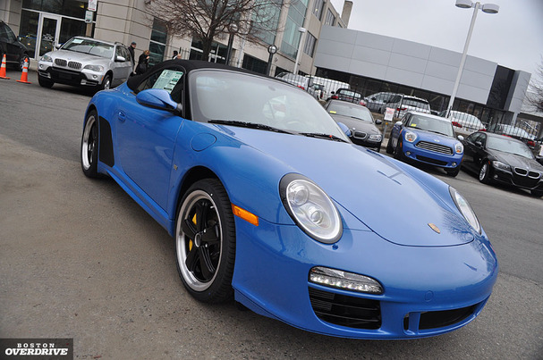 The 2011 Porsche 911 Speedster poses in front of Herb Chambers Porsche in Allston.