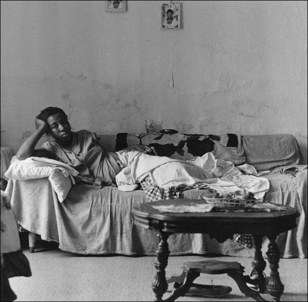 ''Buffalo Lower West Side (woman on couch)'' / 1960, Milton Rogovin