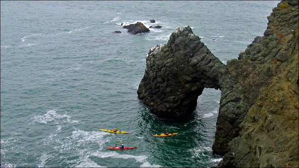 Sea kayakers from above Marin Headlands in Point Bonita, California