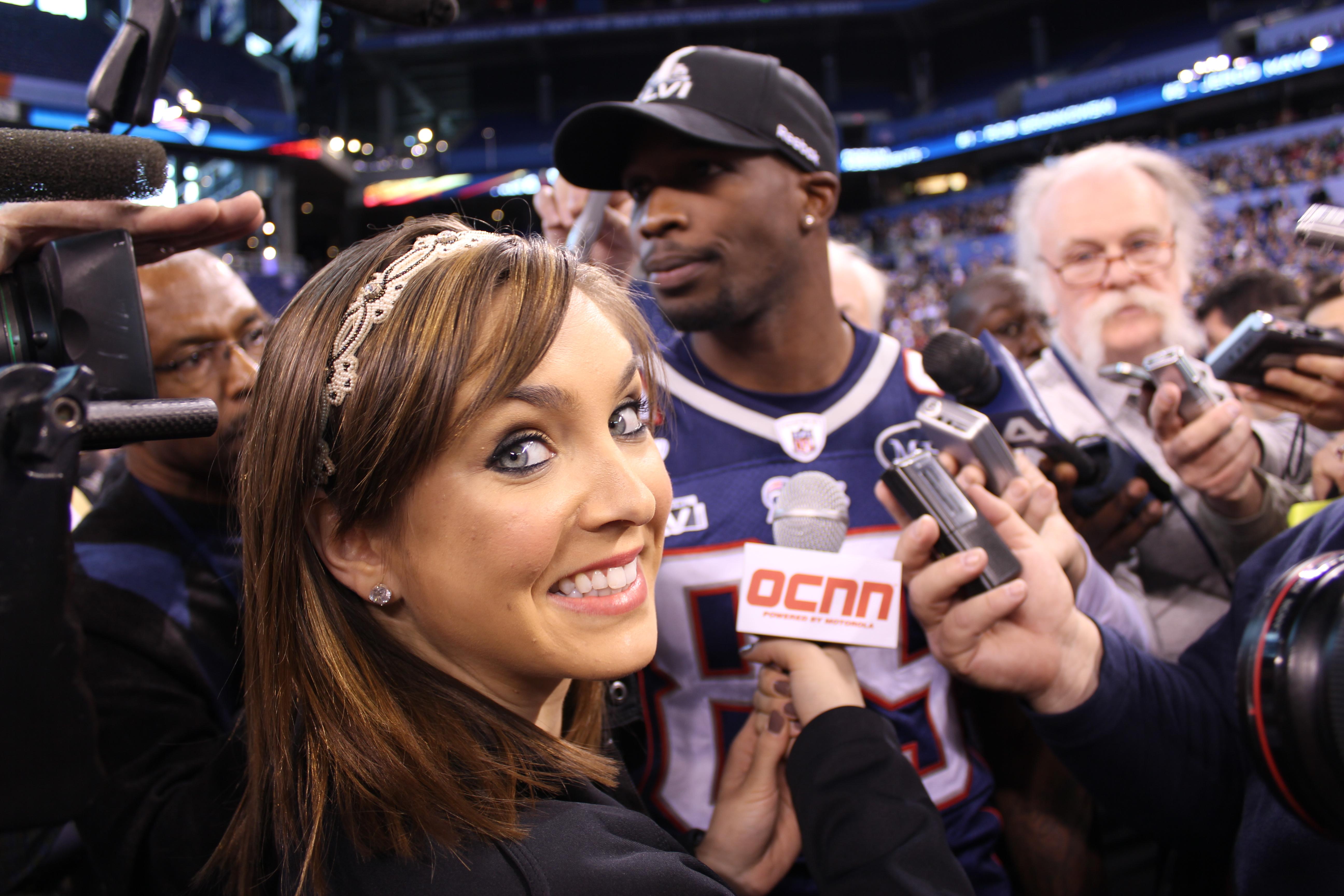 Cassidy Quinn Brettler at Superbowl doing interview.JPG
