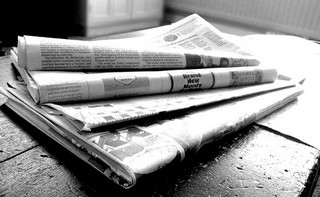 newspapers stack on table black and white.jpg