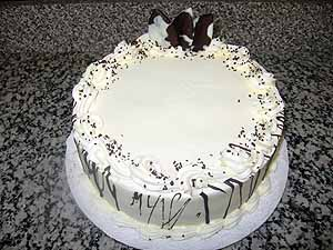 A Birthday Cake With Whipped Cream Frosting Dishing Boston - Real birthday cake images