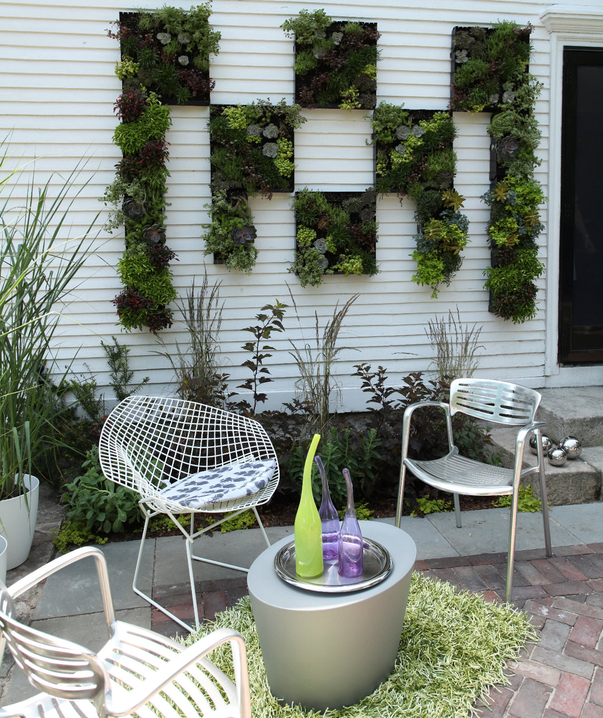 Vertical gardens steal the show | Boston.com on plant wall design, vertical wall lighting, tree garden design, vertical edible gardens, vertical wall water feature, small front garden design, vertical garden plans, vertical wall gardening, vertical vegetable garden kits, vertical vegetable garden design, vertical garden ideas, vertical kitchen garden, vertical lighting design, vertical garden apartment, corner garden design, vertical interior design, small modern garden design, indoor vertical garden design, vertical wall construction, vertical garden planting panel,
