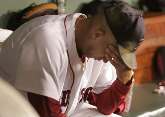 Red Sox starting pitcher Julian Tavarez takes a seat on the team bench after being pulled from the game during the top of the seventh inning. The Boston Red Sox host the Chicago White Sox at Fenway Park in Boston, MA on Monday, September 4, 2006.