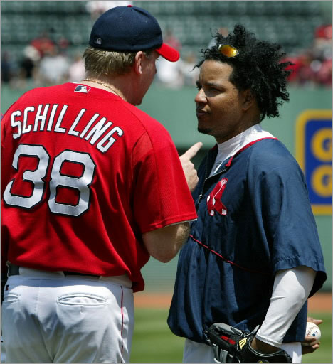 July 11, 2004: Prior to a Red Sox-Rangers game, during batting practice, pitcher Curt Schilling (left) had a rather long, animated conversation with teammate Manny Ramirez (right), who asked out of the starting lineup, sighting a hamstring problem. Schilling did most of the talking.