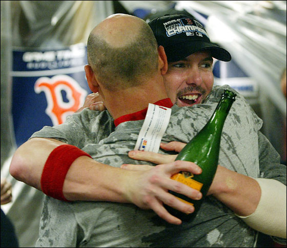 10.27.04: Red Sox manager Terry Francona and Trot Nixon embrace in the clubhouse in St. Louis.