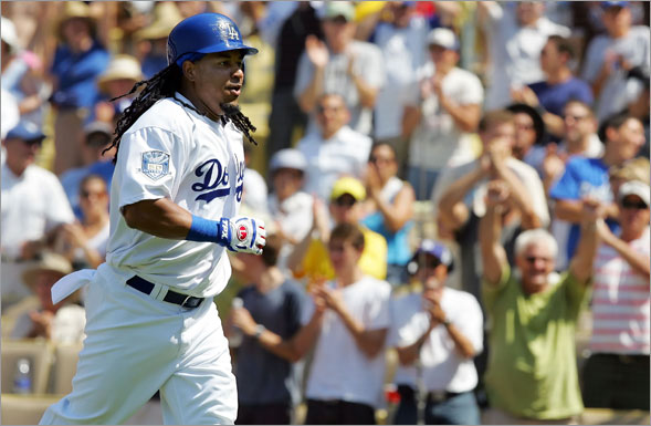 Manny Ramirez of the Los Angeles Dodgers returns to the dugout after hitting a homerun in the fifth inning against the Arizona Diamondbacks at Dodger Stadium on August 3, 2008 in Los Angeles, California.