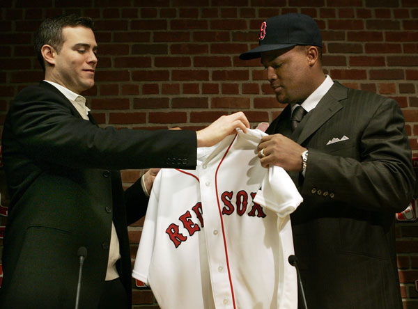Newly-acquired Boston Red Sox third baseman Adrian Beltre, right, is handed his jersey by general manager Theo Epstein at a baseball news conference introducing Beltre at Fenway Park in Boston, Friday Jan. 8, 2007. Beltre and the Red Sox have finalized a one-year contract that guarantees the third baseman $10 million.