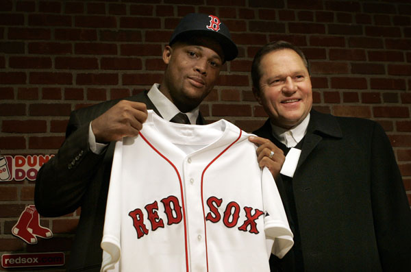 Newly-acquired Boston Red Sox third baseman Adrian Beltre, left,  and his agent Scott Boras pose for a photo at a baseball news conference introducing Beltre at Fenway Park in Boston, Friday Jan. 8, 2007. Beltre and the Red Sox have finalized a one-year contract that guarantees the third baseman $10 million.