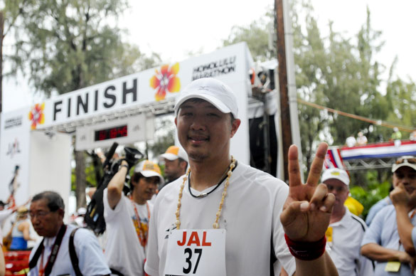 Red Sox pitcher Hideki Okajima gestures after finishing the Honolulu Marathon on Sunday in Honolulu.
