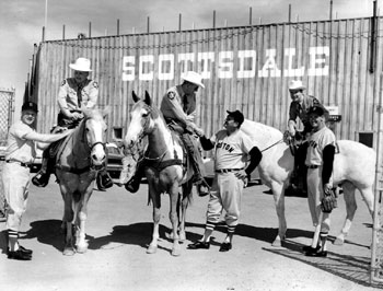 Jackie Jenson, Mike Higgins, and Ted Williams are welcomed to spring training in 1959 by the Scottsdale mounted police.