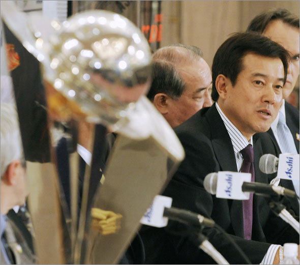 Japan's national baseball team manager Tatsunori Hara, second right, speaks beside the World Baseball Classic trophy (left) during a press conference in Tokyo,  Monday,