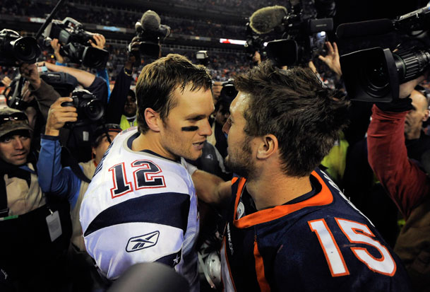 New England Patriots quarterback Tom Brady and Denver Broncos quarterback Tim Tebow meet at midfield after an NFL football game, Sunday, Dec. 18, 2011, in Denver. New England won 41-23.