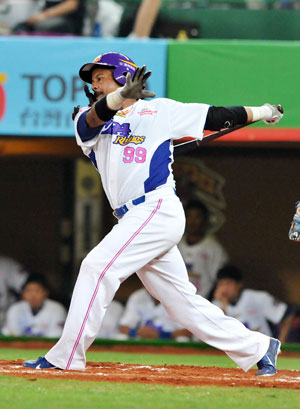 Manny Ramirez, former Boston Red Sox slugger, swings in his debut game for the EDA Rhinos baseball team in Kaohsiung, southern Taiwan on March 27, 2013.