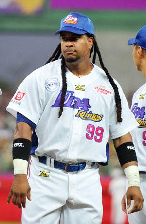 Manny Ramirez, former Boston Red Sox slugger, is introduced to the crowd in his debut game for the EDA Rhinos baseball team in Kaohsiung, southern Taiwan on March 27, 2013.