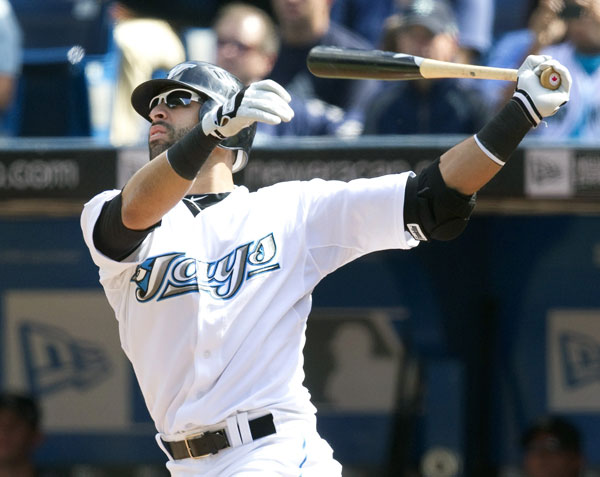 (Reuters) Blue Jays Jose Bautista hits his 50th home run of the season in his first at bat in their American League MLB baseball game against the Seattle Mariners in Toronto September 23, 2010.