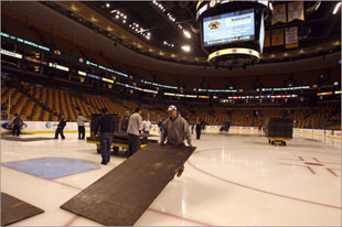 After the Bruins game, the bull gang placed a sub floor in place over the ice. (Globe Staff Photo / Matthew J. Lee)