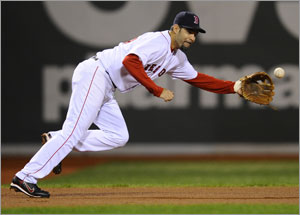 Mike Lowell dives for a grounder in Game 3 of the ALDS.