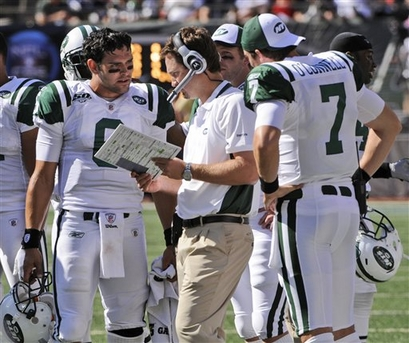 jets-quarterback-mark-sanchez-and-teammate-kevin-oconnell-speak-with-offensive-coordinator-brian-schottenheirmer-on-the-sidelines.jpg