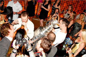 Zdeno Chara drinks from the Cup, while<br>Shawn Thornton has the Midas touch