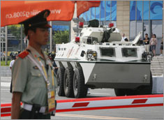 A People's Armed Police armored personnel carrier (APC) is parked outside the front entrance to the main press center in Beijing.