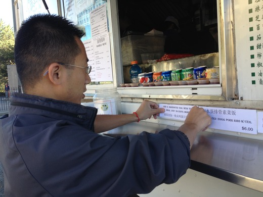 Shuyang Zhao pasting the Thursday Special Menu.jpg